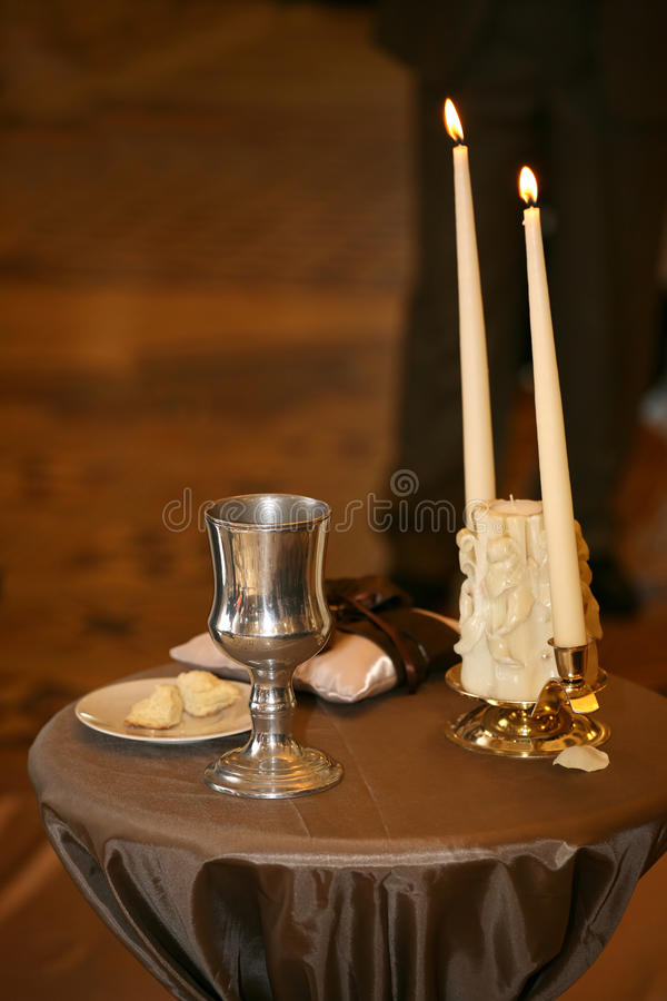 Two decorative candles are lit on the wedding ceremony royalty free stock photography