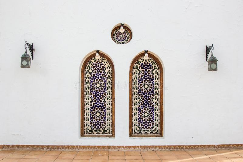 Two decorative niches and lanterns on white building. In Egypt royalty free stock photo