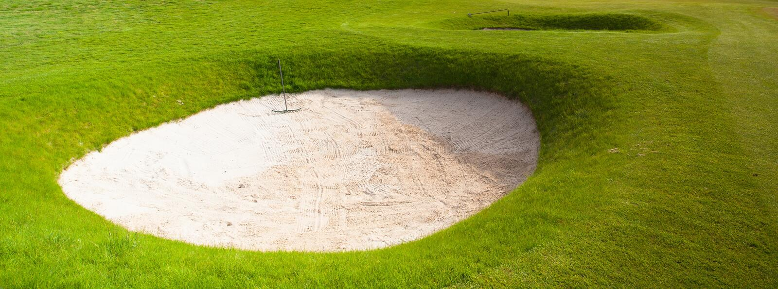 Two deep sand bunkers. On a golf course royalty free stock photography
