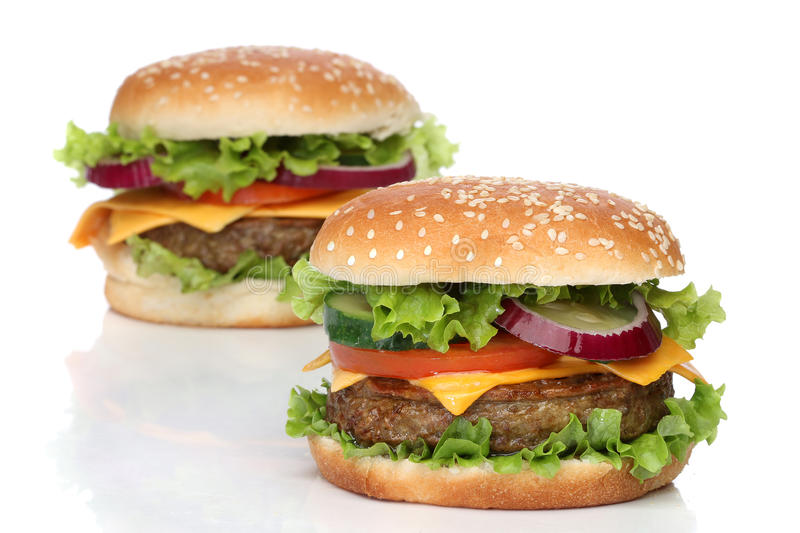 Two delicious hamburgers isolated royalty free stock images