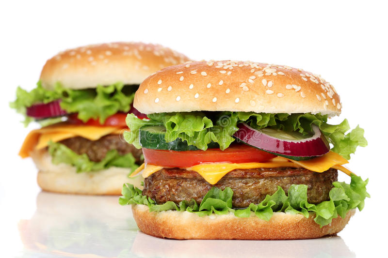 Two delicious hamburgers isolated royalty free stock photos