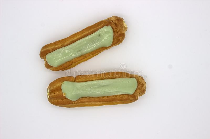 Two Delicious Pistachio Eclairs. An Isolated Image On White Background.  royalty free stock images