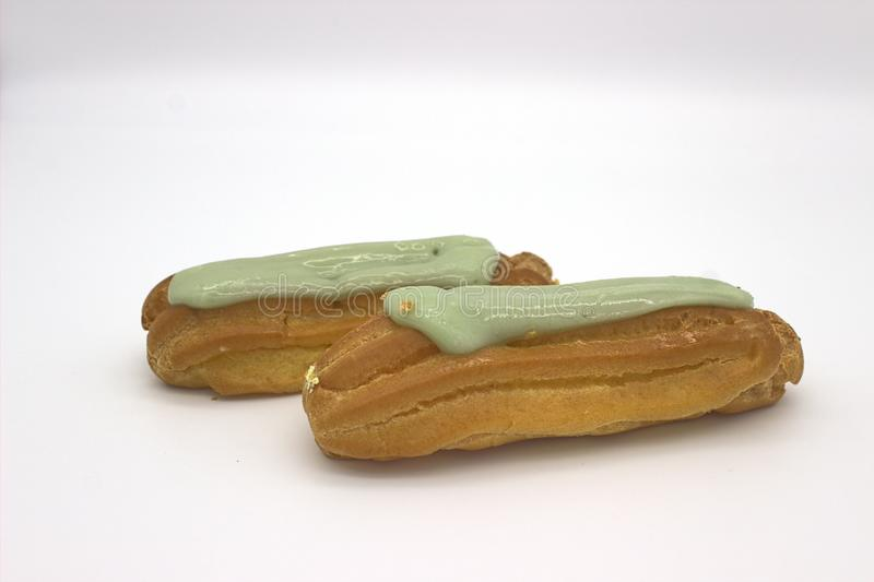 Two Delicious Pistachio Eclairs. An Isolated Image On White Background stock photo