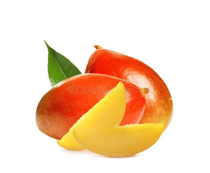 Two delicious ripe mangoes with slices on white. Background royalty free stock photos