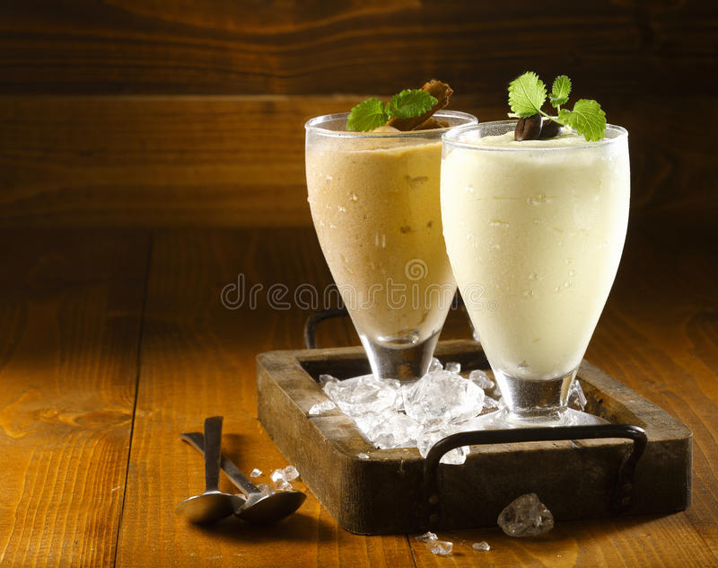 Two delicious thick icecream milkshakes royalty free stock photos