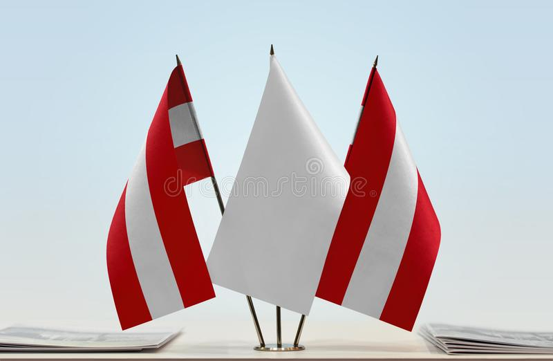 Two flags of Austria. Two desktop flags of Austria with a white flag in the middle royalty free stock photography