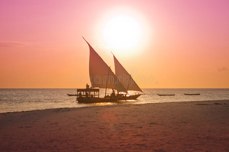 Two dhows in sunset. Two dhows sailing in sunset stock images