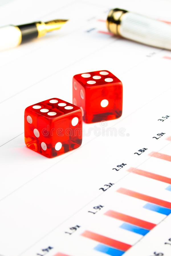 Two dice on stock chart. Detail of red dice on stock chart royalty free stock photos