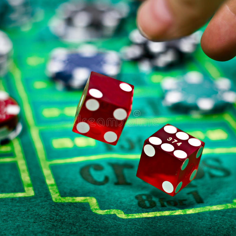 Two dices for craps gambling game. Two dices in a craps table with chips stock images