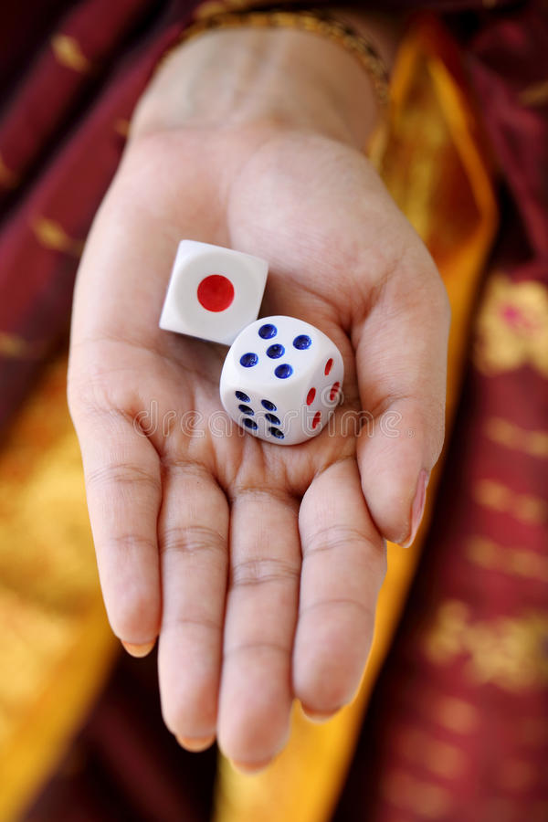 Download Two dices in hand stock photo. Image of close, play, entertainment - 23220782