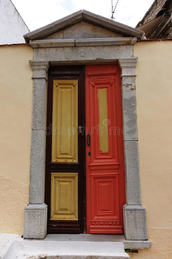 Two different colored door on Symi, greece royalty free stock images