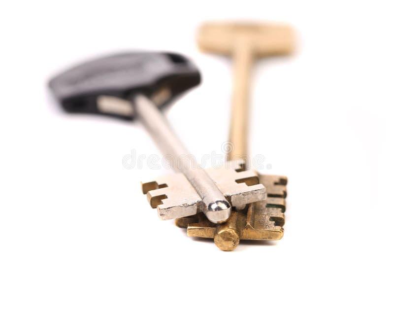 Two different key. Metal. Plastic.