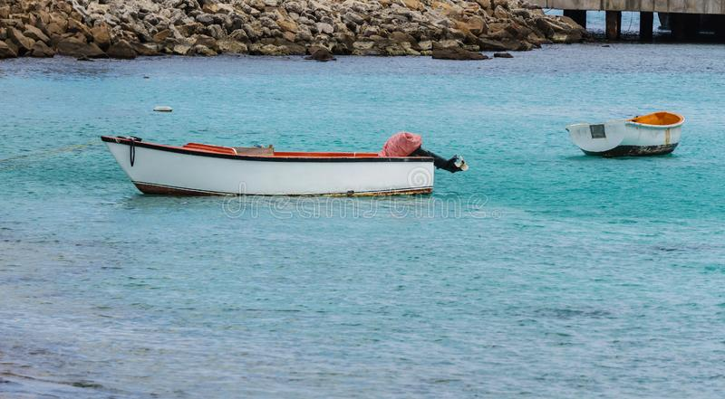 Lost Dinghy. Two dinghies afloat waiting to be used royalty free stock photography