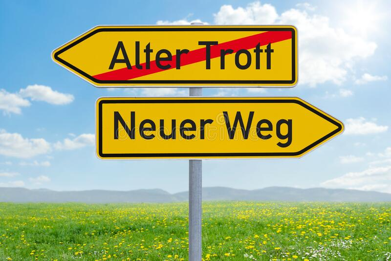Two direction signs - Old Way or New Way - Alter Trott oder Neuer Weg german stock photo