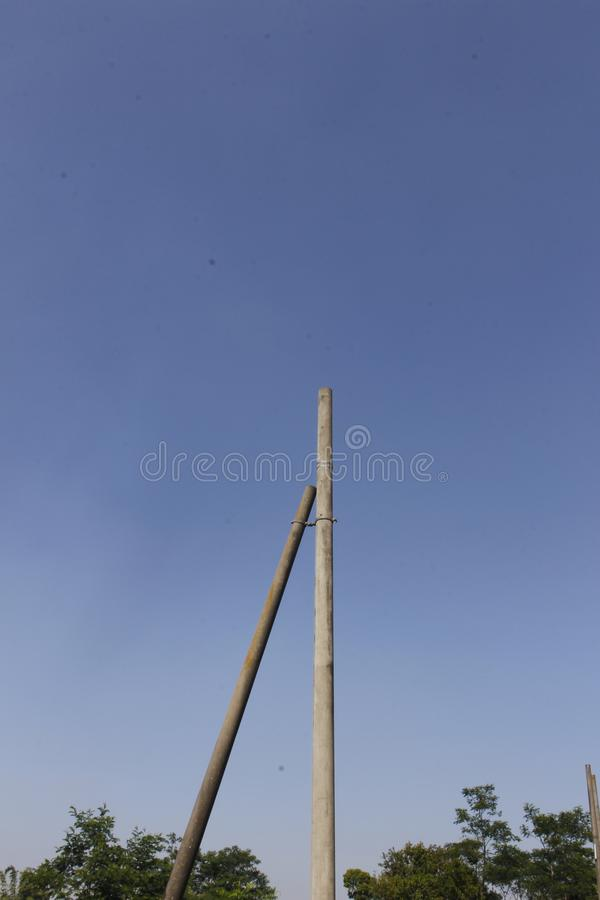 Two Disabled Electric Pole 1 With a Blue Sky Minimalism Background stock image