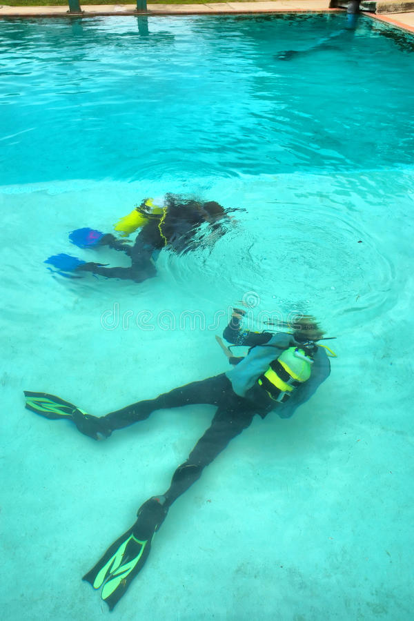 Download Two Divers In Training Pool Stock Image - Image: 33657561