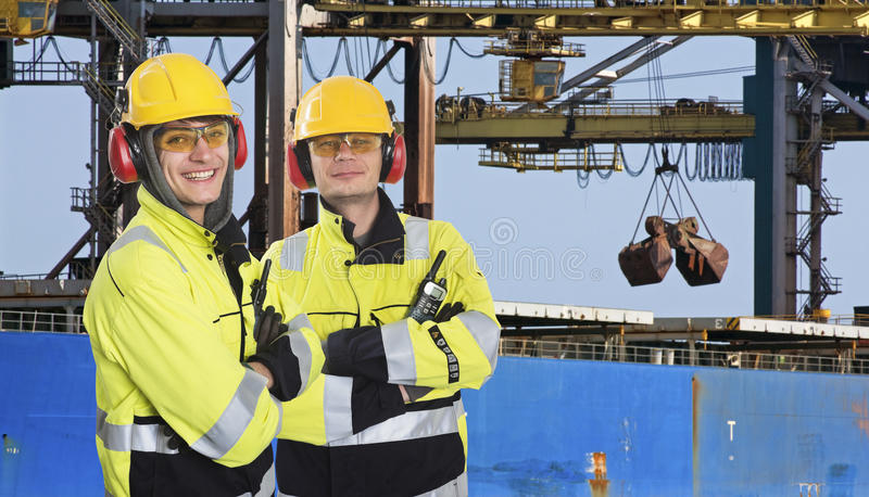 Two dockers at an Industrial Harbor royalty free stock photos