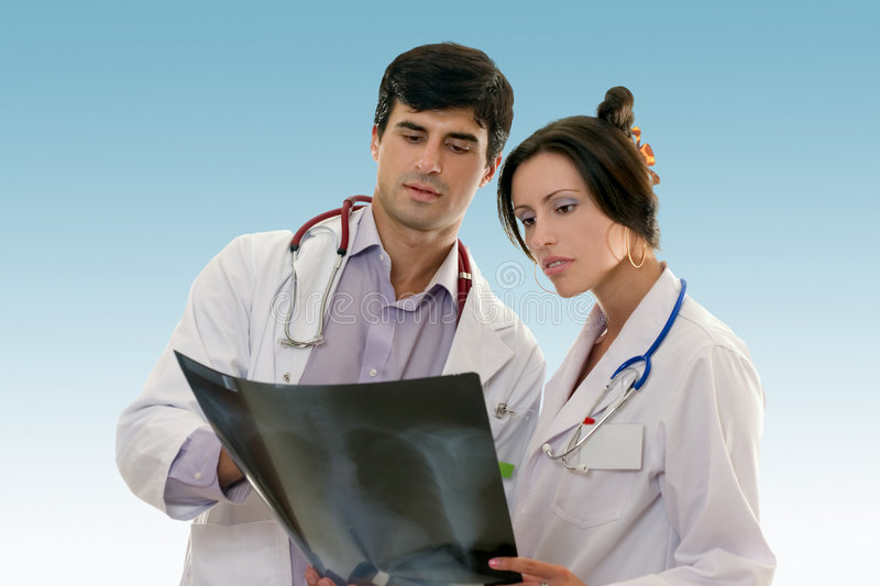 Two doctors conferring over x-ray results stock photo