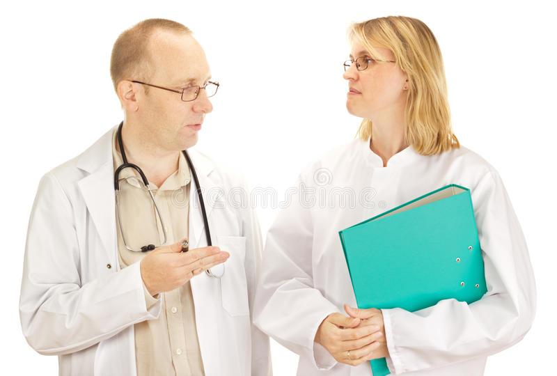 Download Two doctors discussing stock image. Image of hospital - 26554399