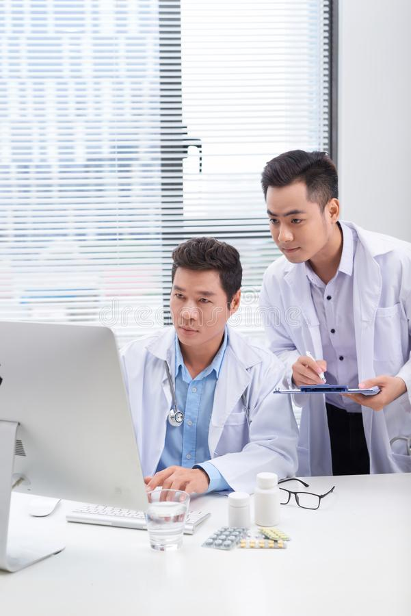 Two doctors discussing a patient`s medical records royalty free stock photos