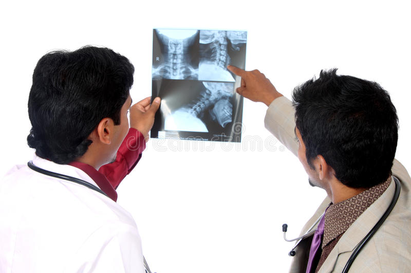 Download Two Doctors Examining The X-ray Stock Image - Image of hands, body: 21025225