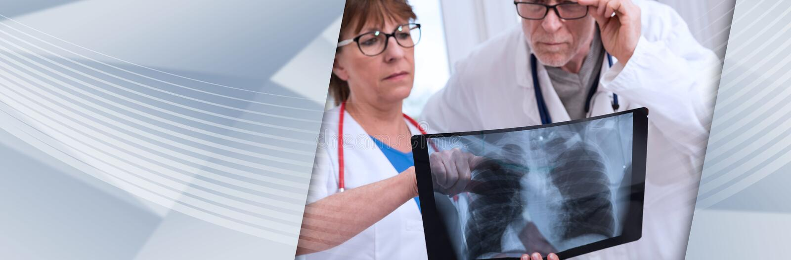 Two doctors examining x-ray report. panoramic banner. Two doctors examining x-ray report in medical office. panoramic banner royalty free stock photos