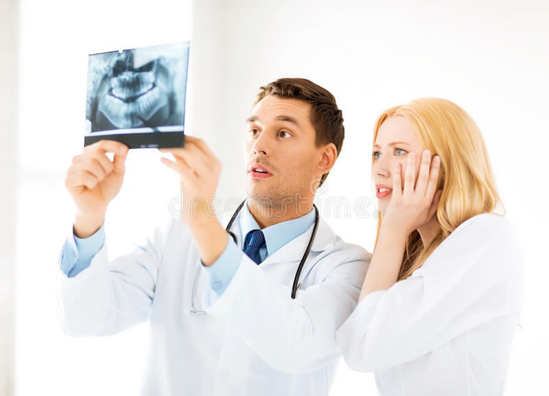 Download Two Doctors Looking At X-ray Stock Image - Image: 32588345