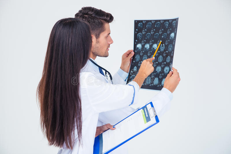 Two doctors looking at x-ray picture of brain stock image