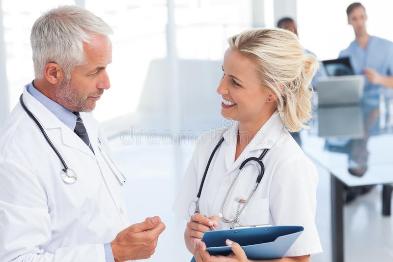 Two Doctors Speaking To Each Other Royalty Free Stock Photos