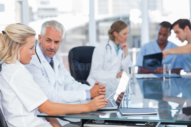 Two doctors using laptop royalty free stock photography