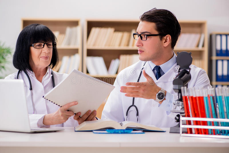 The two doctors working in the lab. Two doctors working in the lab stock photo