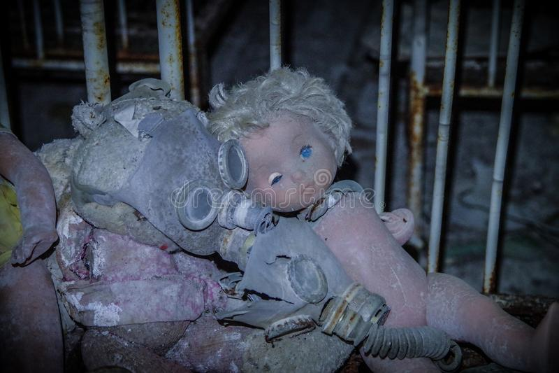 A couple of dolls in the school of Pripyat, Chernobyl zone royalty free stock photos