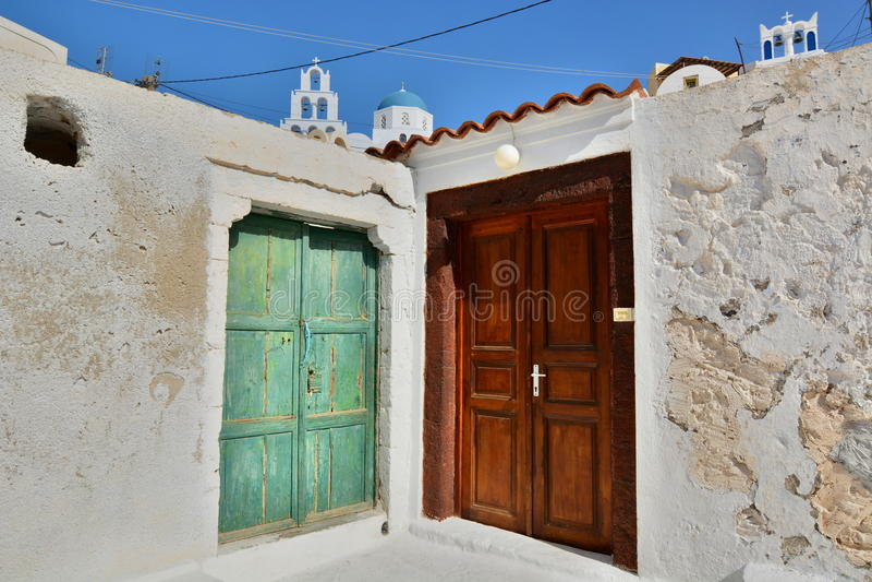 Two doors. Pyrgos Kallistis, Santorini, Cyclades islands. Greece royalty free stock photography