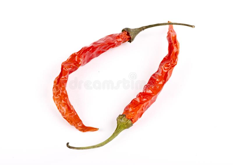 Two dried red chilies spice stock images