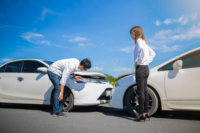 Two Drivers arguing after a car accident. On the road royalty free stock images