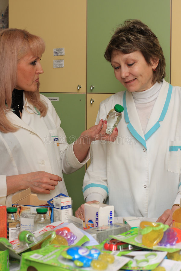 Download Two druggists stock image. Image of filling, people, label - 4832107
