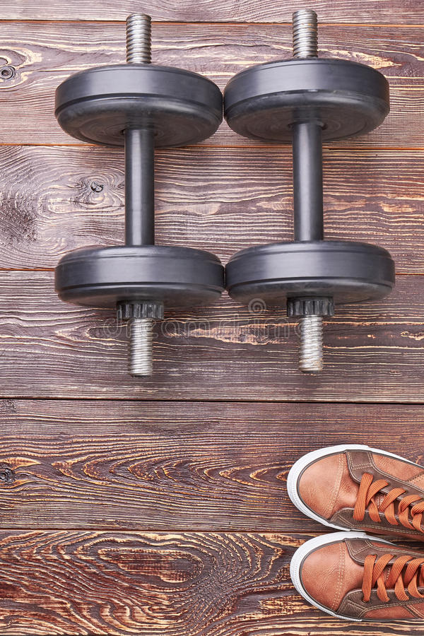 Two dumbbells and sneakers. stock photo
