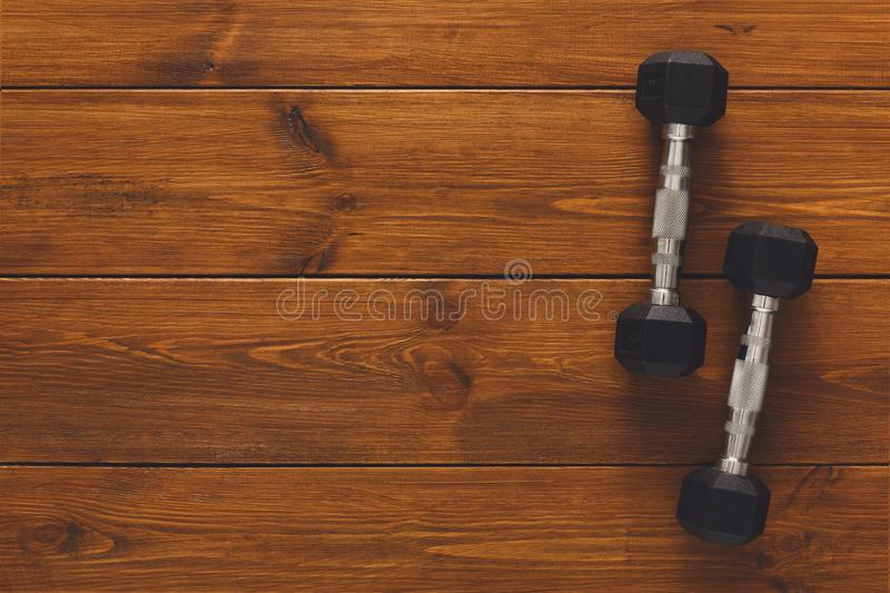 Two dumbbells on wooden background copy space stock photo