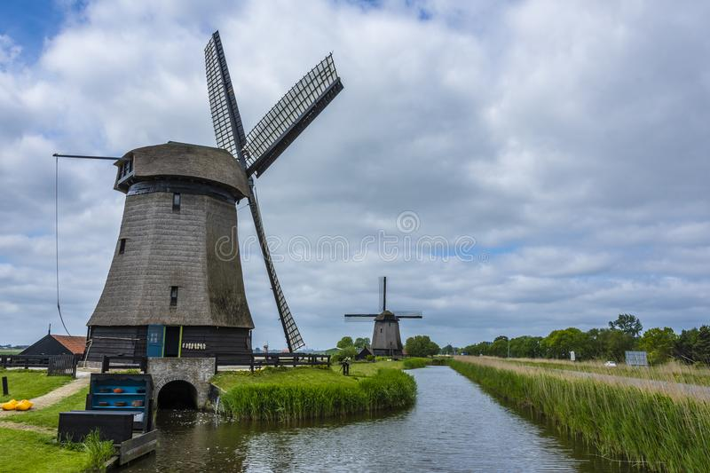 Two Dutch windmills and canal. Oterleek netherlands holland stock photo