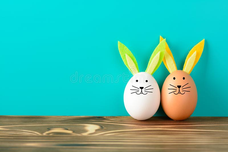 Two Easter Bunny made from eggs on the grass royalty free stock image