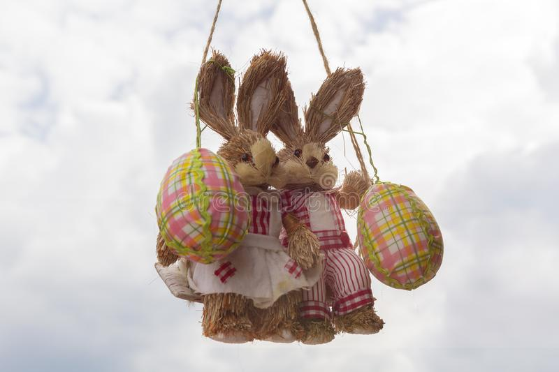 Two Easter bunny on a swing with eggs royalty free stock images