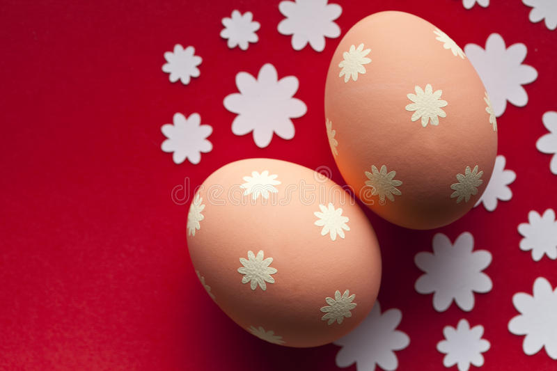 Two Easter eggs on red background royalty free stock photos