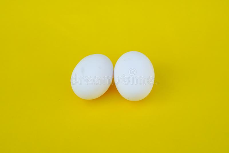 Two Egg with yellow background royalty free stock photo