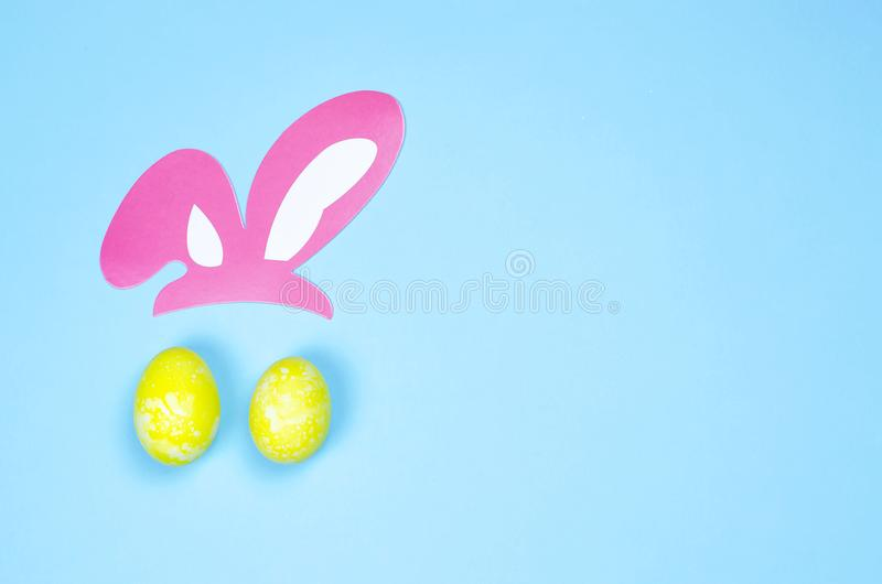 Two eggs and ears imitating the face of the Easter Bunny. royalty free stock images
