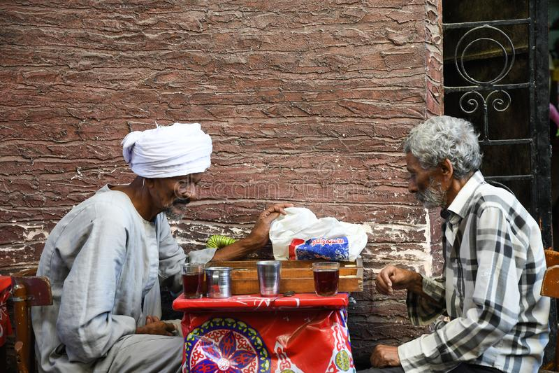 Two elder men playing chess on the street stock photos