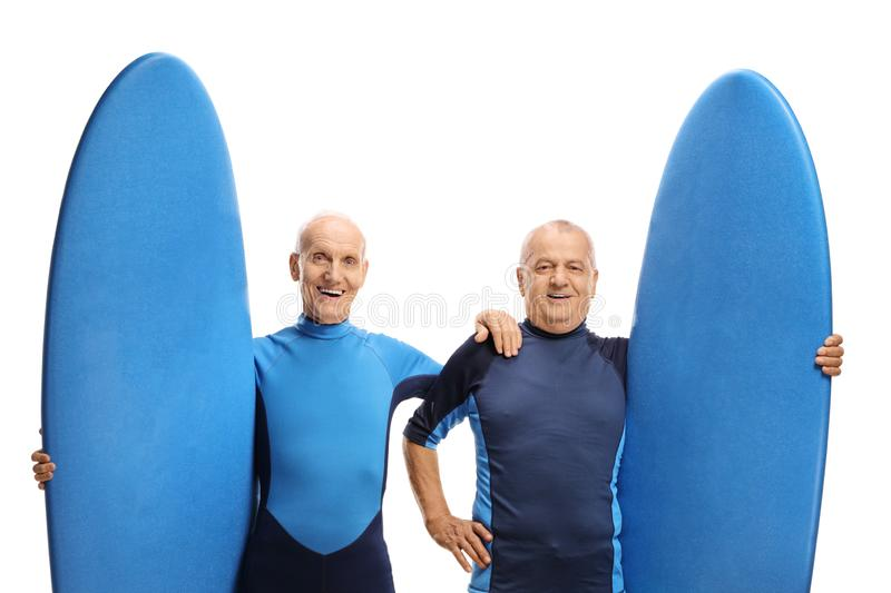Two elderly men with surfboards stock photography