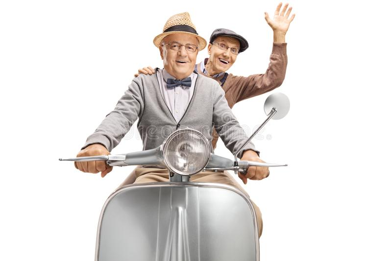 Two elderly men on a vintage scooter, one waving. Isolated on white background royalty free stock image