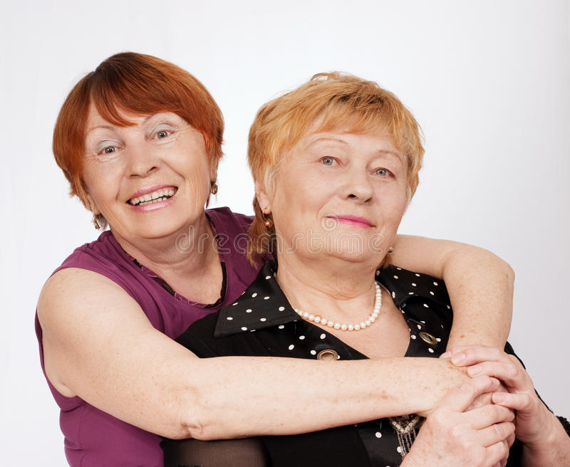Two elderly sisters stock images