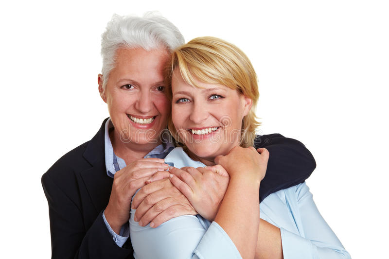 Two elderly women embracing stock photo