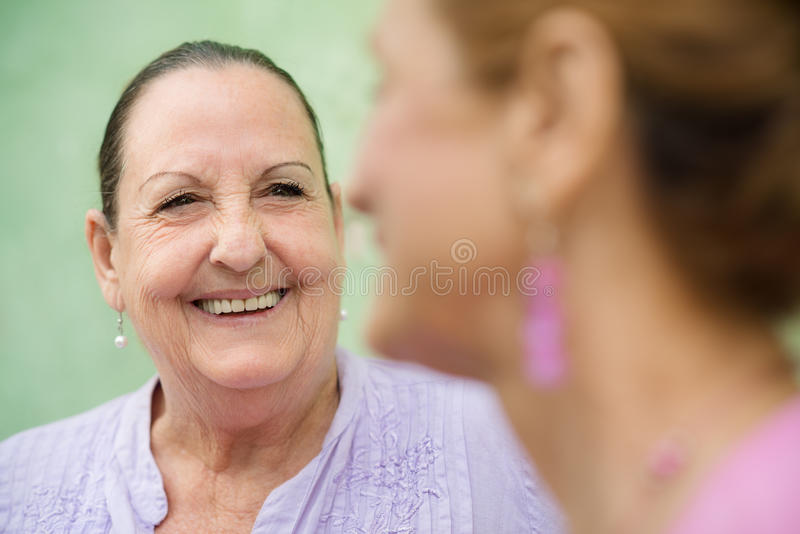 Download Two Elderly Women Talking On Park Bench Stock Photo - Image: 26507296
